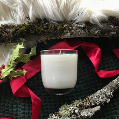 vegan soy wax old fashioned christmas candle by wooly beast naturals in an etched cocktail glass
