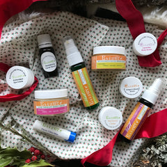 essance organic skincare on white polka dot with cleanser moisturizer lip balm serum eye cream with red ribbon