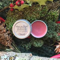 vita vie mint rose lip butter organic on moss with wood pinecones and holly berries in background
