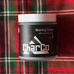 essance organic charco shave cream on plaid background