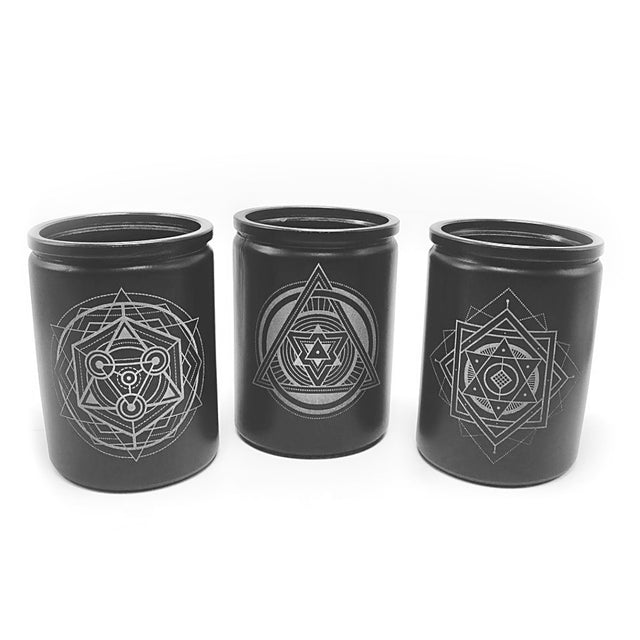 black sacred geometry soy candles laser engraved on white background