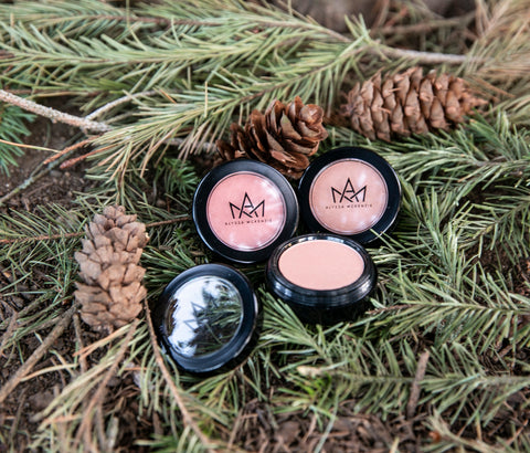 alyssa mckenzie cosmetics blush on pine and pinecone tree background