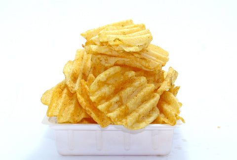 fried potato chips on white background on white plate