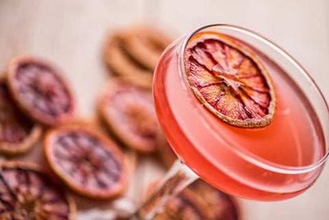 blood orange pink cocktail with sliced blood oranges
