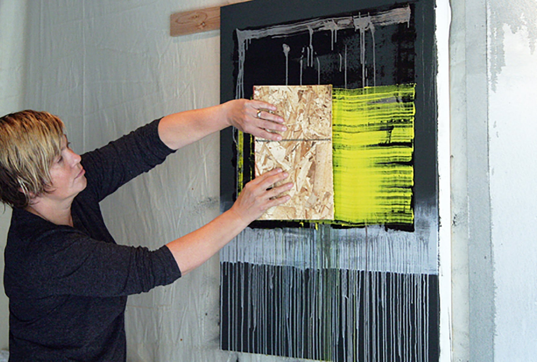 Artist Danie Wood Painting in her Studio
