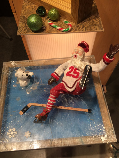 Santa plays hockey - wipes out on the ice-kenfolks