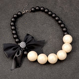 Gwenda Chic Bow Wooden Beads Necklace
