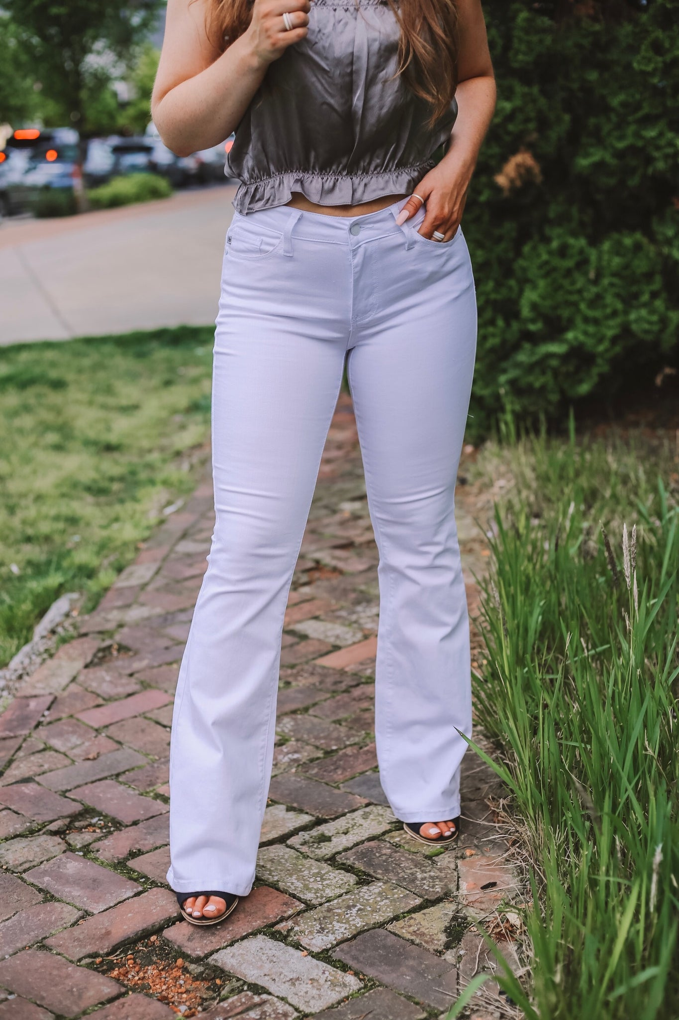 When In White Flared Jeans