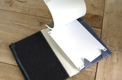 Store your finished notes in the opposite pocket