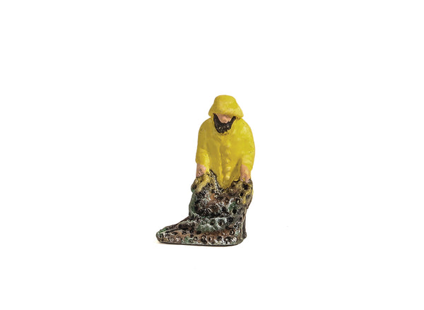 Fisherman in Yellow Oilskins with Net