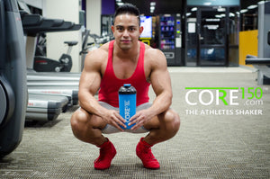 bodybuilder holding core 150 protein shaker cup blue