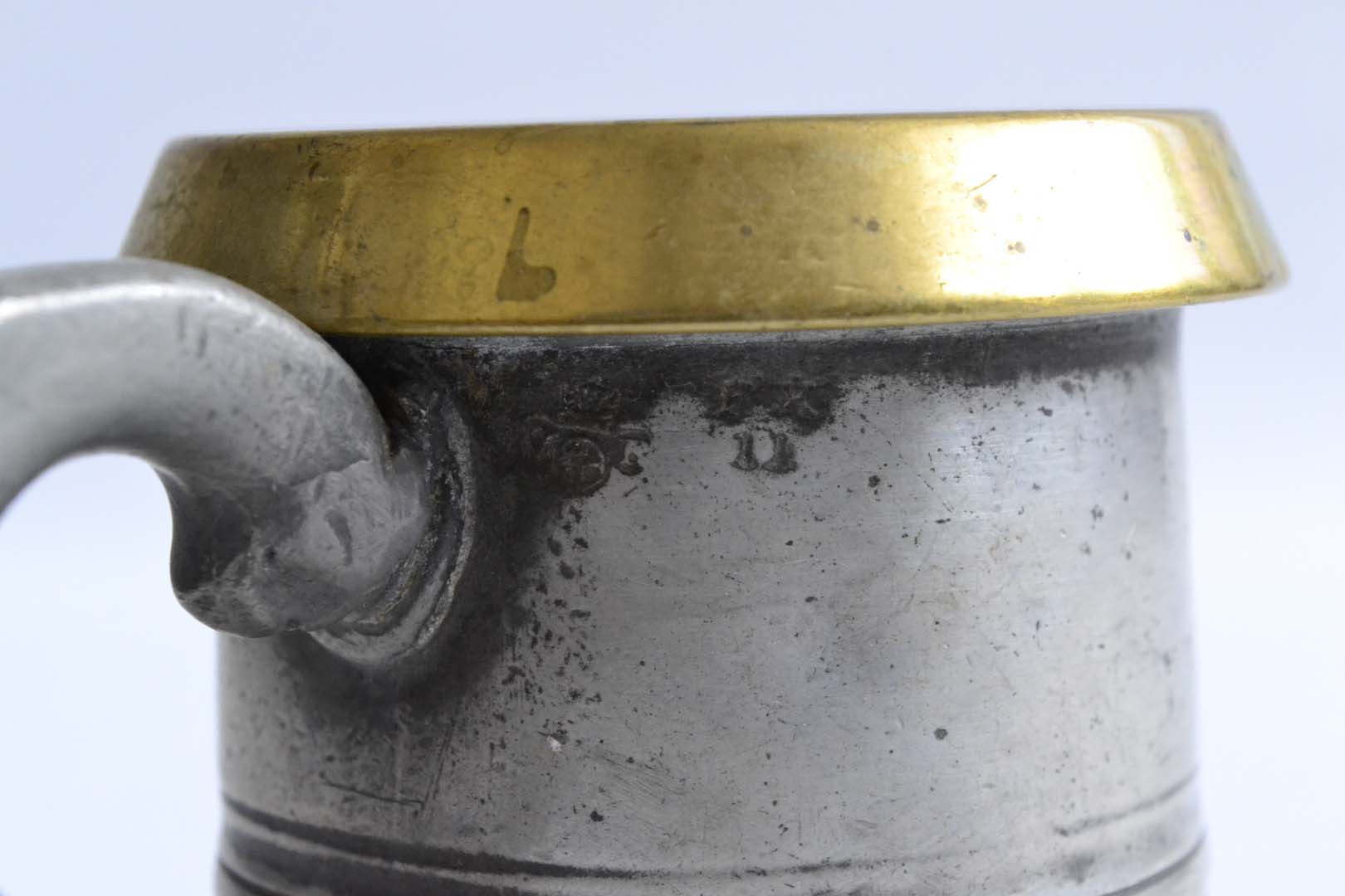 Half Pint Pewter Measure with a Brass Rim