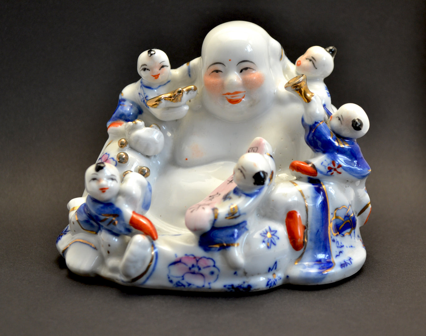 Porcelain Laughing Buddha Figure with Five Children