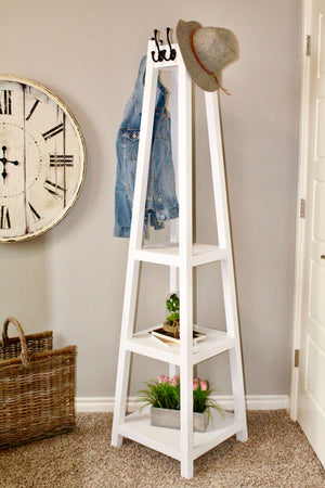DIY Coat Rack featuring black hooks to hang coats for the home entryway