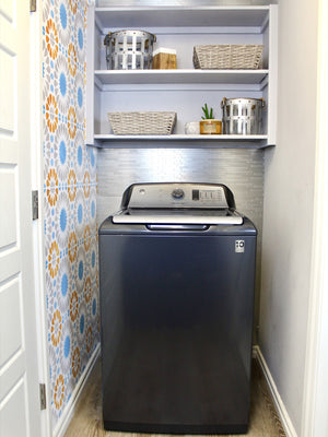 Laundry Room Makeover featuring a wall stencil, vinyl flooring and peel and stick tile