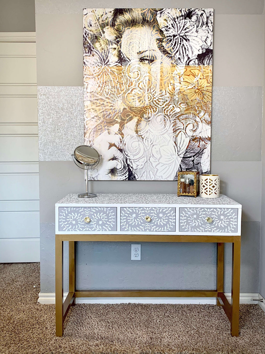 DIY Makeup Vanity Desk featuring a stenciled design and golden desk base underneath an Oliver Gal art piece