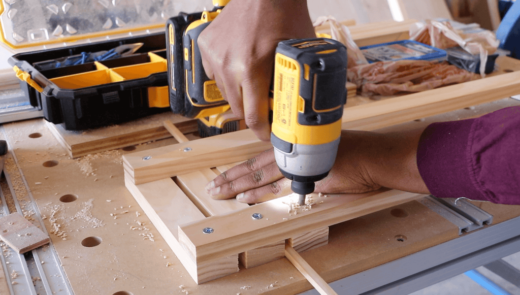Drilling pilot holes into 1x2 lumber using a Dewalt Impact Drill