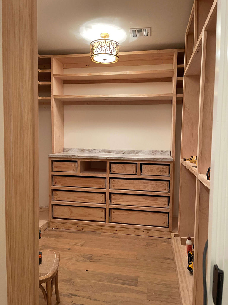 Installing drawers for the master closet