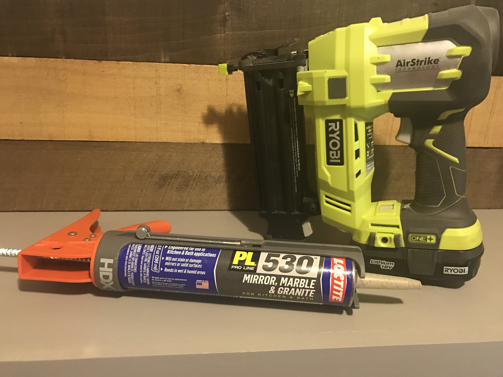 Ryobi Brad Nailer posed in front of weaver Lumber wall boards