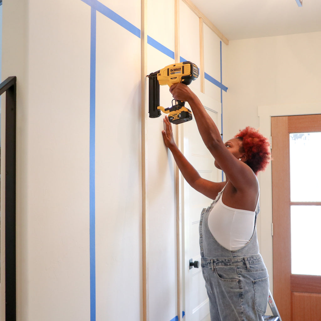 Installing wall paneling with a dewalt brad nailer