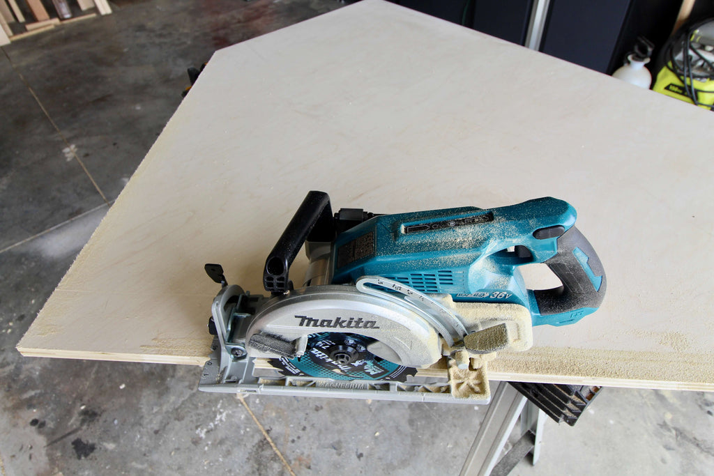 Cutting out a house shape on plywood with Makita Rear Handle Circular Saw