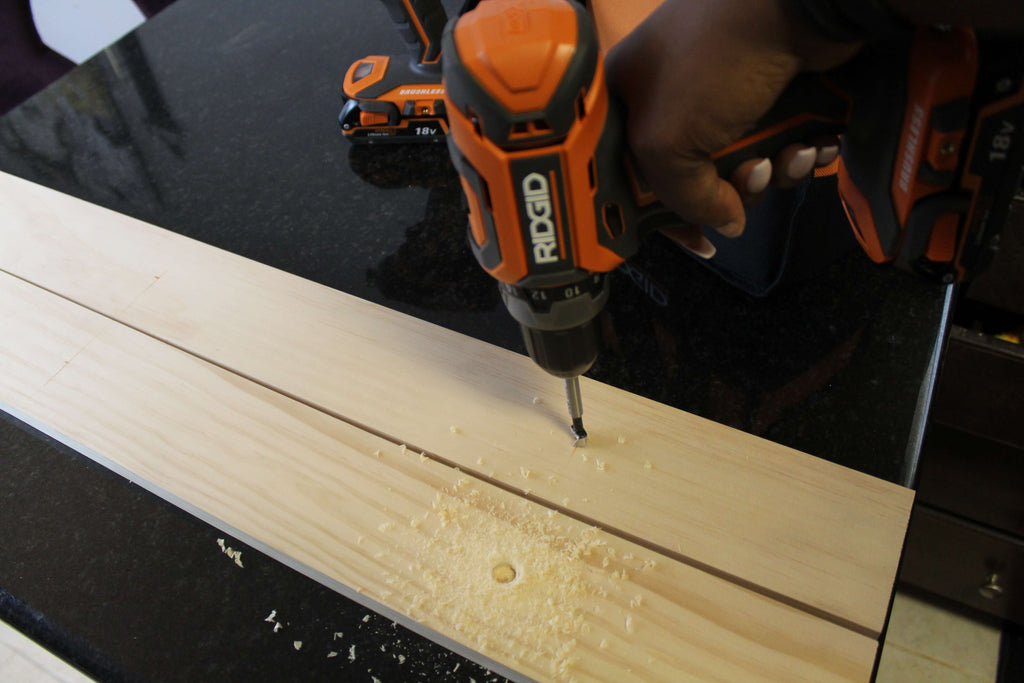 Drilling holes for a magazine rack using the RIDGID Drill/Driver