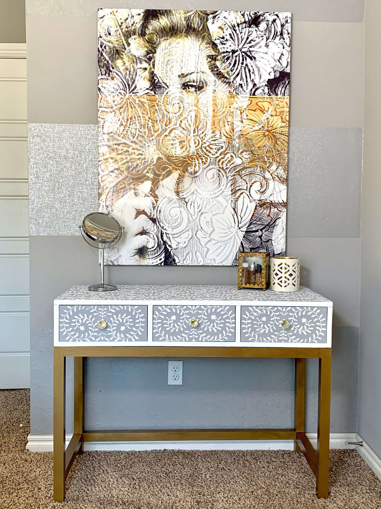 Vanity Desk with Stenciled Design and Gold Legs under a Oliver Gal Art Piece