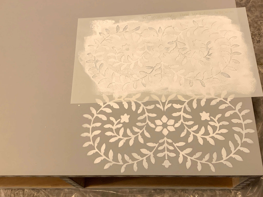 Priya Bone Inlay Cutting Edge Stencil being painted on a DIY Vanity Desk
