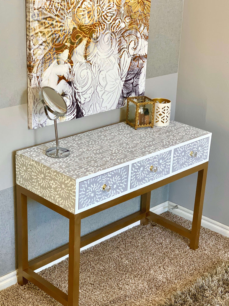 DIY Makeup Vanity desk with a stenciled design and gold legs