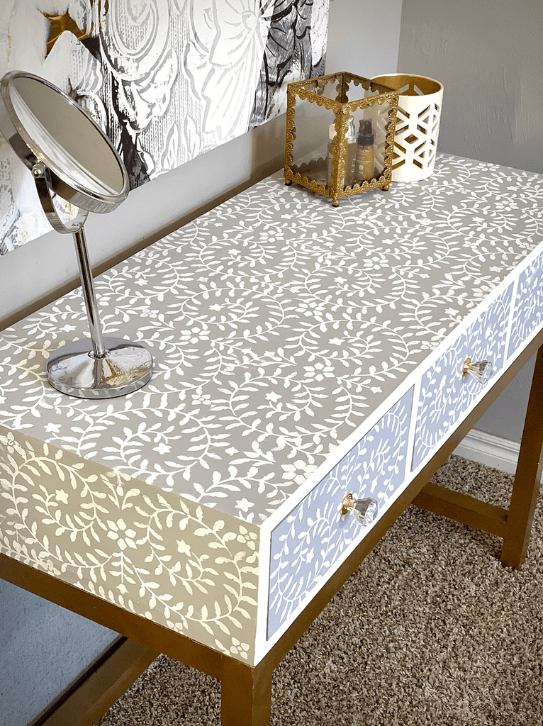 Makeup Vanity desk featuring a stenciled design and gold desk legs