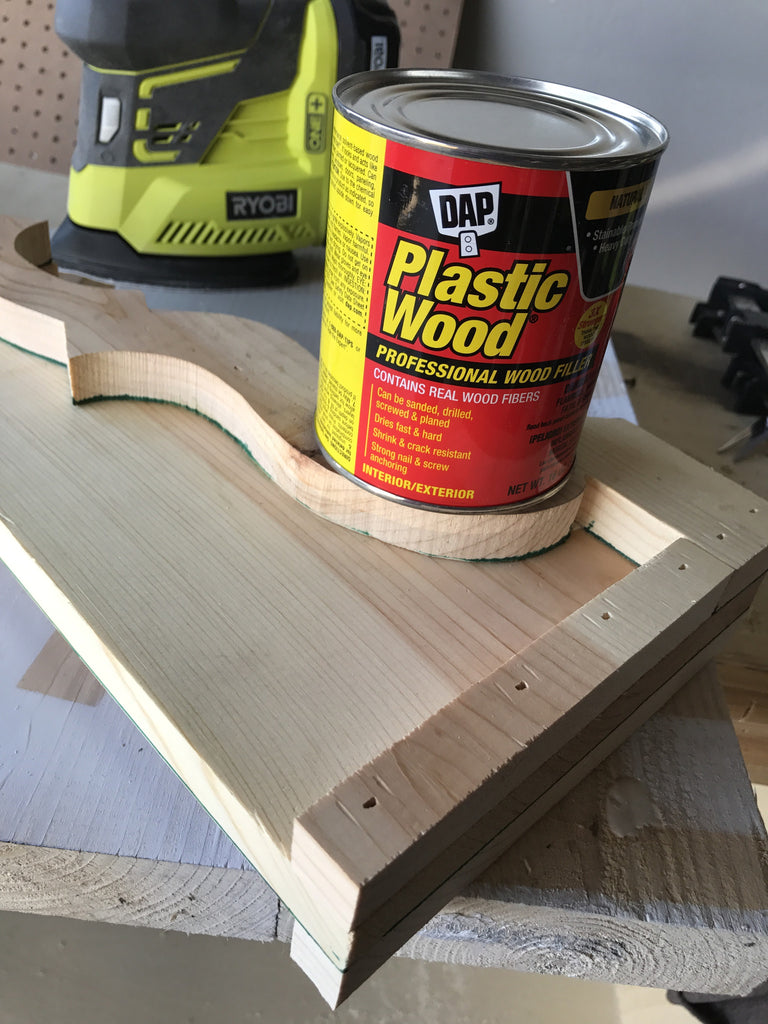 Filling nail holes on Handmade Corbel with DAP plastic wood