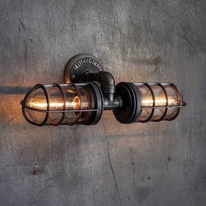Darkened steel cage light wall sconce