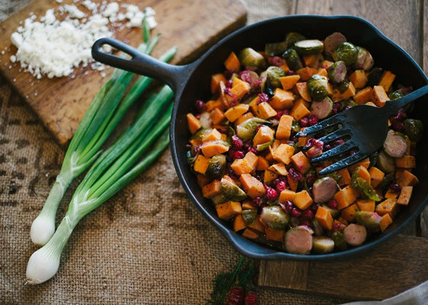 RAMP DRESSING ROASTED BRUSSEL SPROUTS, SWEET POTATOES AND CRANBERRIES WITH FETA
