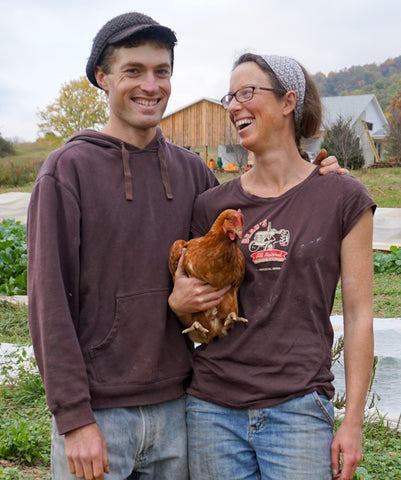 Ben Stowe and Heather Coiner with chicken at Little Hat Creek Farm