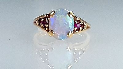 Vintage Opal ring in 14k yellow gold with two small round Ruby on sides
