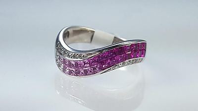 Pink Sapphire & diamond invisible set ring.