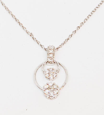 Diamond illusion setting pendant with 0.50ct diamonds.