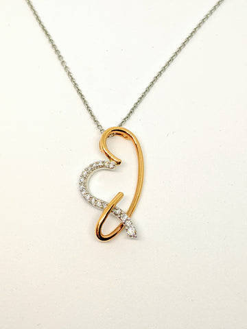 Rose and white gold fancy diamond heart pendant.