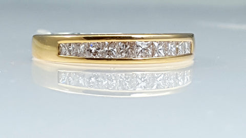 Princess cut diamond wedding band channel set