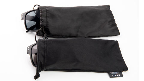 Real and fake Oakley Holbrook sunglasses in their cloth pouch