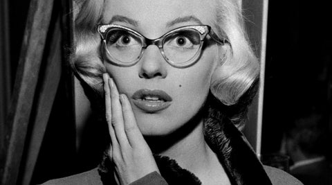 For women, in the 1950s Cat Eye glasses became very popular. This picture shows Marilyn Monroe wearing the popular cat eye glasses in a film