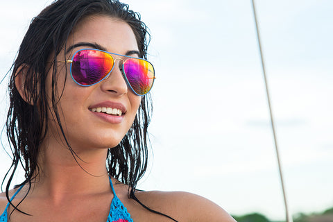 Close up of woman wearing colorful sunglasses.