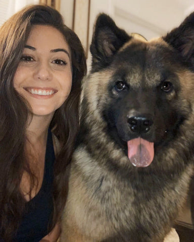 Selfie of Fuse employee Gabrielle with dog Kato inside