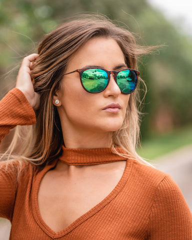 woman posing with green mirror lenses