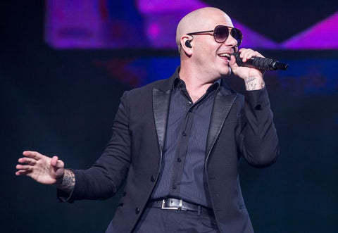 Rapper Pitbull performing at song, photo taken by Scott Legato through Getty Images