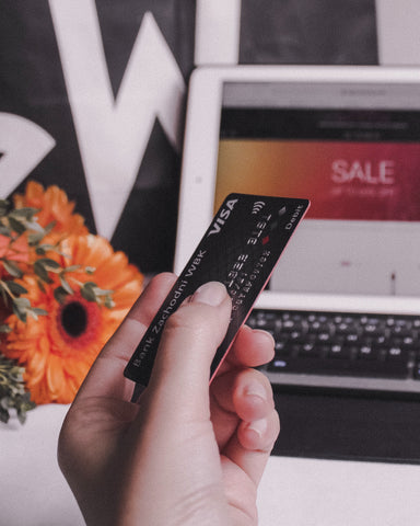 Shopping online during a sale while using a credit card. Photo taken by ostshem on unsplash.