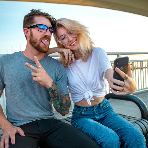 A man and a woman with bluelight lenses on, taking a selfie.