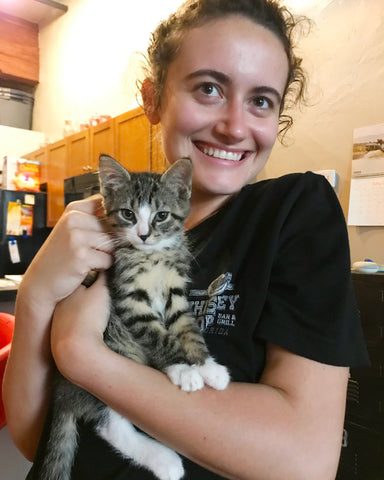 Customer Service Agent Danielle at home with striped cat Alex