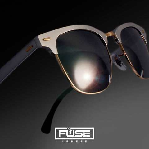 Silver frames with our Carbon, dark grey lenses. The Fuse Lenses logo located in the bottom.
