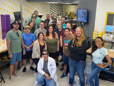 The fuse team stands in the lens lab and poses for a picture